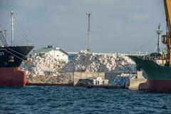 Maldives rubbish island garbage in flames in male Stock Photos