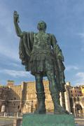 Rome Giant Emperor Bronze Statue near imperial forums - stock photo