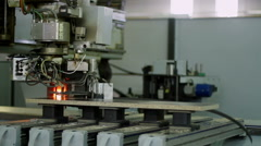 High-tech equipment. The process of gluing the edge to the detail of furniture. - stock footage