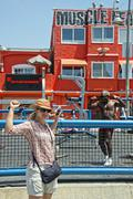 LOS ANGELES, USA - AUGUST 5, 2014 - excercise of black man in muscle beach  i - stock photo