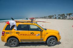 LOS ANGELES, USA - AUGUST 5, 2014 - lifeguard yellow car in venice beach land - stock photo