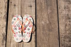 Flip flop on wooden background - stock photo