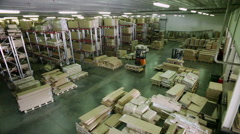 Top view of furniture warehouse storage . Racks with packed details of furniture Stock Footage