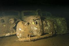 Old Car inside II world war ship wreck hold - stock photo