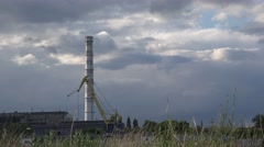 Pipe and crane on background of stormy sky, stormy weather, 4K Stock Footage