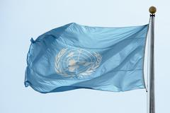 NEW YORK - USA - 11 JUNE 2015 Waving united nations UN flag in the deep blue  Stock Photos