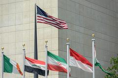 Flags waving outside united nations building in manhattan new york Kuvituskuvat