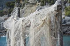 Fishing net hanging for drying - stock photo