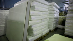 Warehouse storage of upholstered furniture. Packed details of furniture. Arkistovideo