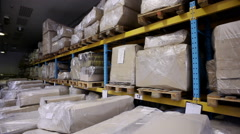 Warehouse storage of upholstered furniture. Packed details of furniture. Stock Footage