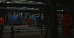 4K Engineers walking through power plant with other workers in background Stock Footage
