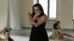 Dancers performing and practicing a contemporary, modern form of dance. - stock footage