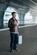 Full length portrait young happy smiling handsome traveller man in 20s leaving - stock photo