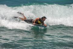 HONOLULU, USA - AUGUST, 14 2014 -  People having fun at hawaii island beach Stock Photos