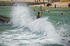 HONOLULU, USA - People having fun at waikiki beach in Hawaii Oahu island Stock Photos