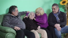the union of the family around the elderly mother: tenderness and affection - stock footage