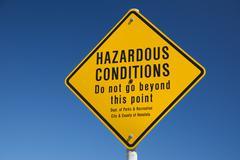 Hazardous conditions danger sign in hawaii on the shore Stock Photos