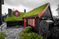 Far Oer downtown grass roof wood house - stock photo