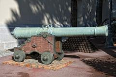 Medieval iron Cannon with ammo - stock photo