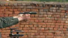 close-up, the soldiers were shooting with guns - stock footage