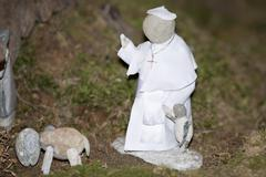 pope francis stone statue - stock photo