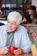 Grumpy Mature Man in Coffee House Stock Photos