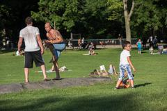 NEW YORK - USA - 14 JUNE 2015 people is spending time amusing in central park - stock photo