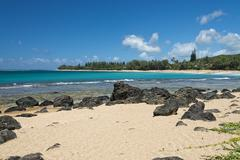 Waves on Hawaii beach panorama on windy day - stock photo