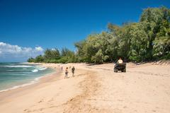 HONOLULU, USA - AUGUST, 14 2014 -  People having fun at hawaii island beach - stock photo