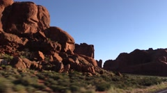 Driving in Arches National Park, morning glory and color - stock footage