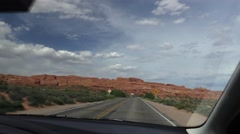 Driving in Arches National Park, passing rv motorhome Stock Footage