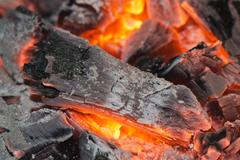 Red hot wood embers detail in fire place Stock Photos
