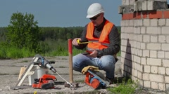 Builder using tablet PC and measuring tape - stock footage