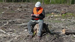 Environmental inspector writing in the destroyed forest Stock Footage