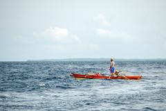 BUNAKEN, INDONESIA - APRIL, 5 2014 - fishing ship returning to fisherman vill Stock Photos