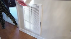 Man Changing Dirty Air Filter In House - stock footage