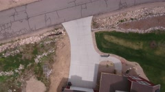 Aerial shot flying over rural neighborhood with big homes Stock Footage