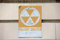 Yellow fallout shelter sign on a building Kuvituskuvat