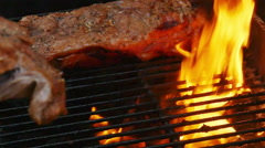 Ribs and Fire on Grill Being Cooked in Slow Motion Stock Footage
