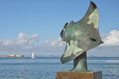 Manta copper statue by the sea - stock photo