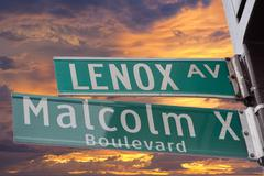 Green new york street sign: Malcom X and Lenox Kuvituskuvat