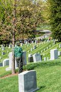 WASHINGTON D.C., USA - MAY, 2 2014 - worker is cleaning white tombstones at A - stock photo