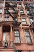 NEW YORK, USA - JUNE 15, 2015 - American people walking in Harlem on weekday Stock Photos