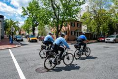 WASHINGTON D.C., USA - MAY, 2 2014 -  bicycle policemen in Georgetownon sunny Kuvituskuvat