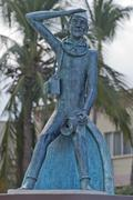 Jacques Cousetau copper statue in mallejon promenade by the sea Stock Photos
