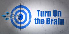 Education concept: target and Turn On The Brain on wall background - stock illustration