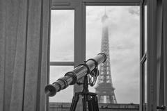 Paris tour eiffel view from room with telescope Stock Photos