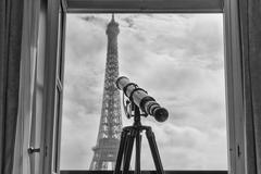 paris tour eiffel view from room with telescope - stock photo