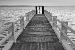 Wooden platform on the sea in b&w Stock Photos