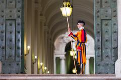 VATICAN CITY, ITALY - MARCH 1, 2014 : A member of the Pontifical Swiss Guard, - stock photo